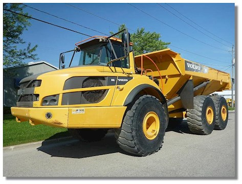 2011 Caterpillar 730 - Volvo Dump Trucks